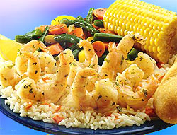 Hmmm... do they really serve these many shrimp? Yes... Perhaps the plate is tiny! : ) Pic: Shrimp Scampi, seasoned rice, vegetable medley, French breadstick, corn on the cob and Fresh Lemon wedge